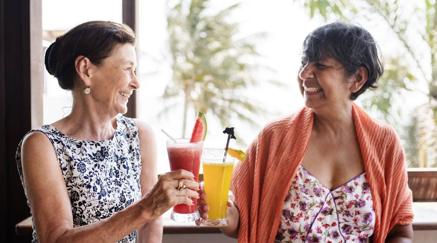 two women enjoying drinks